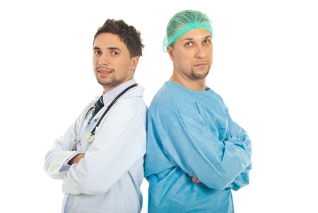 Different two doctors men standing back to back with arms folded and looking at camera isolated on white background photo