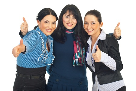 Three united beautiful business women giving thumbs up isolated on white background photo