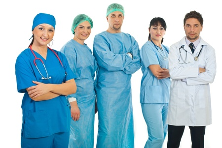 Hospital doctor woman in uniform standing with arms folded in fornt of her team of different doctors photo