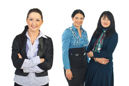 mid adults: Smiling young busienss woman in front of camera and her team of mid adults business women in background