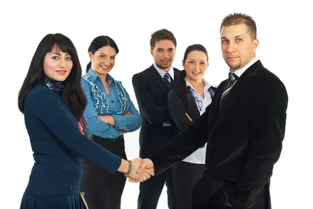 Business  man and woman gives handshake in front of their team isolated on white background photo