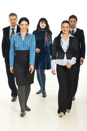 Full length of five cheerful  business people walking  and smiling photo