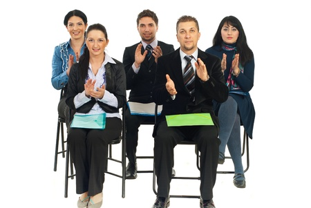 clap: Five business people sitting on chairs at conference and applauding isolated on white background