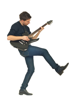 man playing guitar: Dancing young man playing guitar isolated on white background Stock Photo