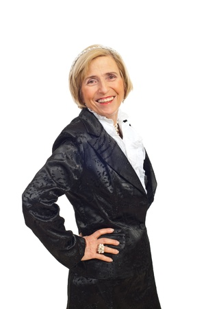 Beautiful senior woman in elegant shinny suit and wearing pearls isolate don white background photo