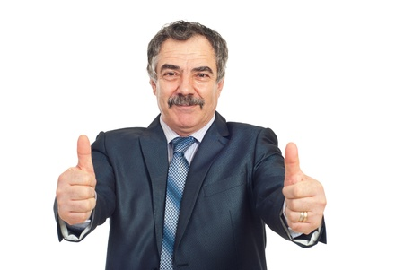 Successful mature business man giving thumbs up and smiling isolated on white background photo