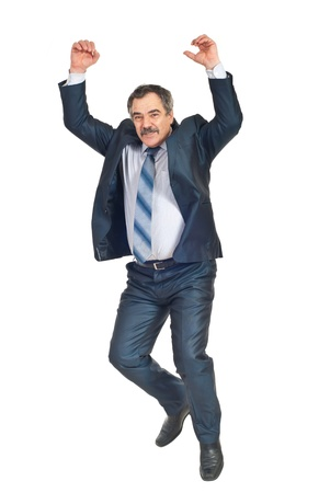 Happy successful business man jumping with arms raised isolated on white bakground photo