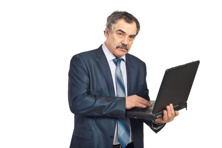 Mature executive man using laptop and looking at camera isolated on white background photo