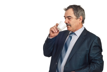 business for the middle: Middle aged business man standing in semi profile and drinking a cup of coffee in a business break,copy space for text message in left part of image isolated on white background