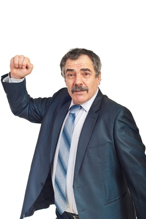 Nervous and confused mature business man showing his fist isolated on white background Stock Photo - 8816114