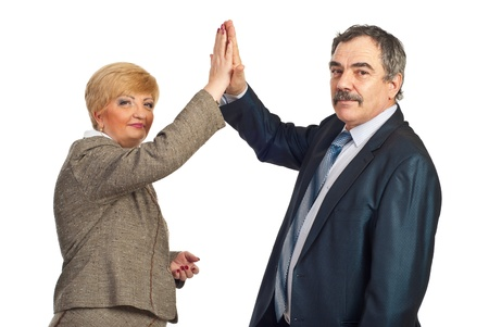 Mature business people giving high five and looking at camera isolated on white background Stock Photo - 8816146