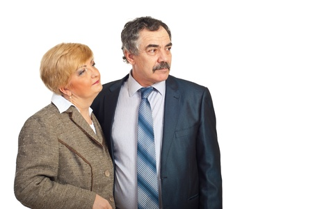 Two middle aged business people looking away to copy space and thinking at perspectives for future isolated on white background photo
