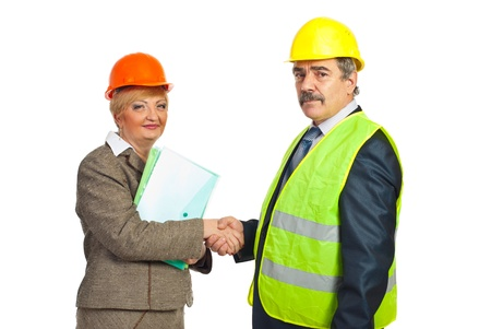 two middle aged architects shaking hands  for an agreement isolated on white background photo