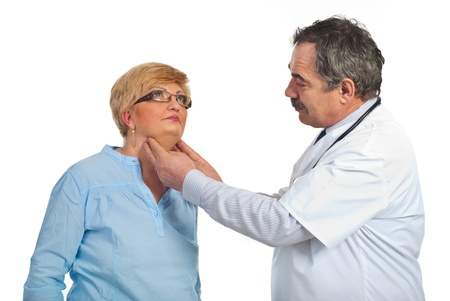 Mature endocrinologist checking goiter to a middle aged patient woman with glasses isolated on white background Stock Photo