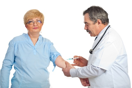 Mature doctor man vaccine patient woman with glasses isolated on white background photo