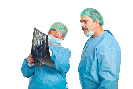 Two mature surgeons review magnetic resonance imaging and having conversation isolated on white background photo
