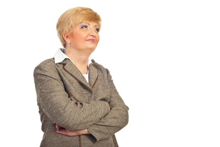 Middle aged executive woman looking to the future and thinking isolated on white background photo