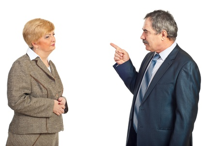accuse: Upset manager mature man accuse his employee woman isolated on white background