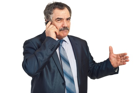 explanations: Mature executive man giving explanations and talking at phone mobile isolated on white background