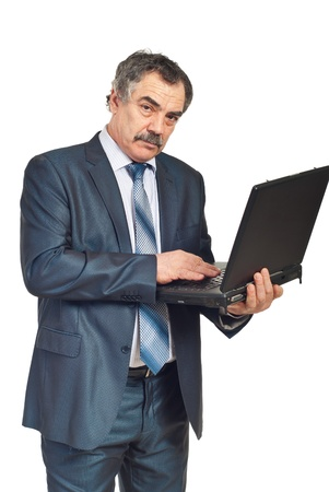 Mature corporate man with mustache working on laptop isolated on white background photo