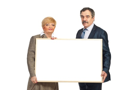 Two mature business people holding a blank banner isolated on white background photo
