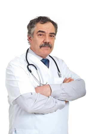 Friendly mature doctor man standing with arms folded isolated on white background photo