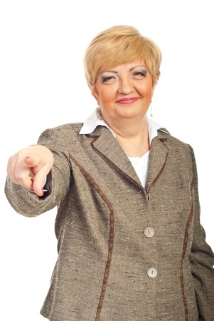 Smiling mature business  woman pointing to you isolated on white background photo