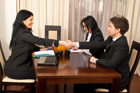 Successful job interview  ,two business people giving hand shake and smiling photo