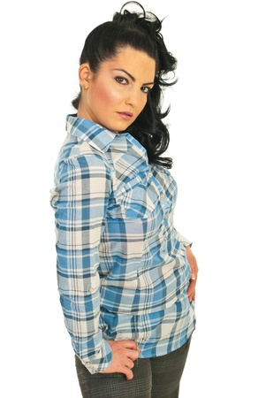 Attractive fashion model woman posing in a blue shirt with squares isolated on white background photo
