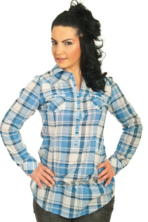 Beauty brunette woman posing in a blue cool shirt isolated on white background photo