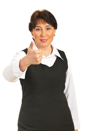 Smiling mature executive woman giving thumb up isolated on white background Stock Photo - 8990288
