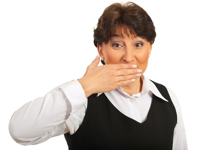 Amazed mature woman cover mouth with her hand isolated on white background photo