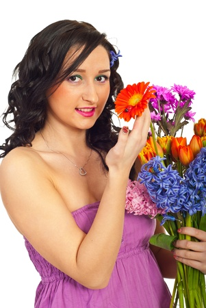 Happy woman holding bouquet of various flowers isolated on white background photo
