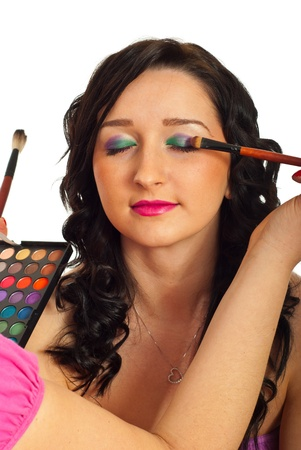 eyesclosed: Model woman getting eyeshadows make up in two colors isolated on white background
