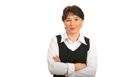 mains crois�es: Smiling mature businesswoman standing with hands crossed isolated on white background,copy space for text message in left part of image