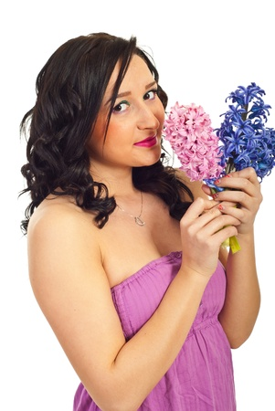 Cute young woman smelling bouquet of hyacinth isolated on white background photo