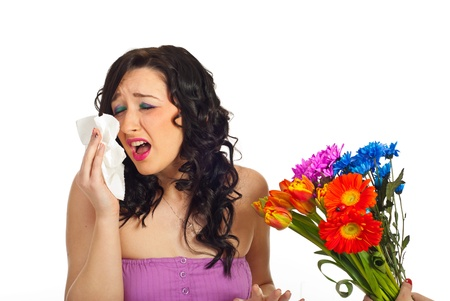 Woman  having allergy from spring  flowers isolated on white background photo