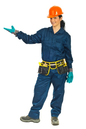 Beauty constructor worker woman in protective uniform welcome you to copy space isolated on white background photo