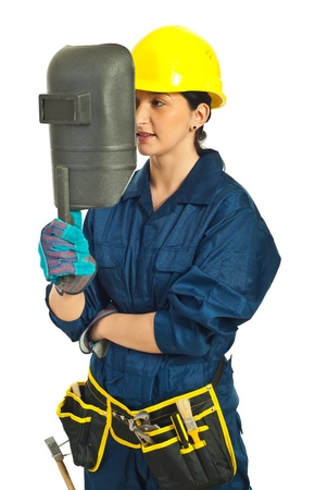 Worker woman holding welding mask isolated on white background photo