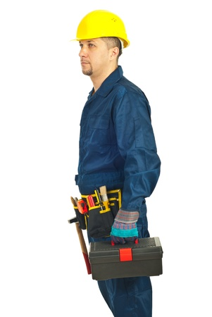 Profile of repairman holding tool box and looking in perspective isolated on white background photo