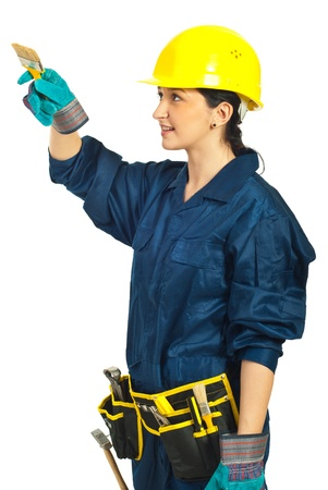 Worker woman holding brush and painting isolated on white background photo