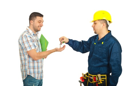 happy client: Builder man giving keys to happy client man isolated on white background