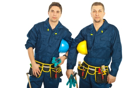 Handsome constructors workers men team holding helmets isolatd on white background Stock Photo
