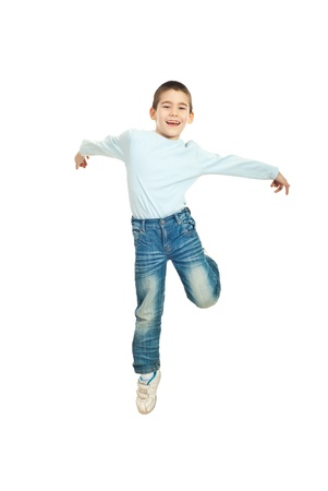 Jumping happy kid boy against white background photo