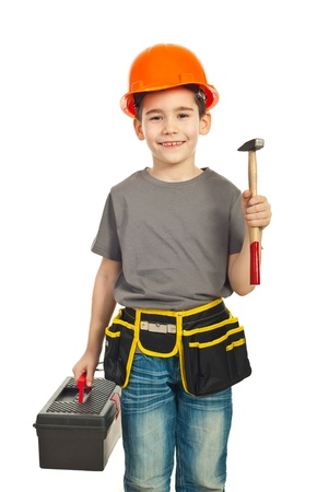 builders: Small constructor kid boy holding hammer and tools container isolated on white background