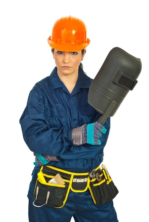 Serious welder worker woman holding welding mask against white background photo