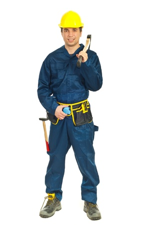 Full length of young worker man holding ax on his shoulder over white background photo