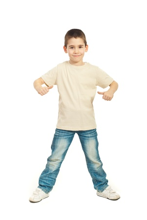 child model: Full length of boy in blank beige t-shirt showing  thumbs isolated on white background