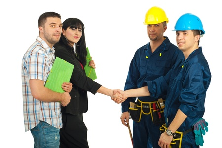 Mid adult couple and workers team having an agreement and giives hand shake over white background photo
