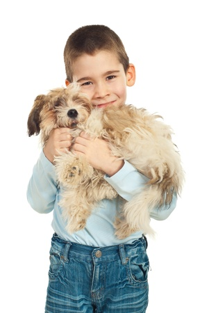 Boy loving and bonding his puppy fluffy dog over white background photo